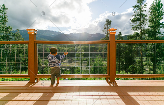 Toddler on deck with mountain view