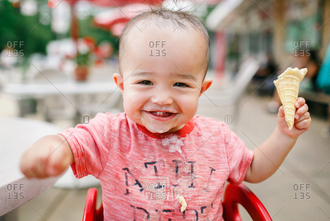 Smiling toddler with ice cream