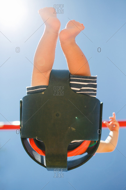 Underside of boy in swing