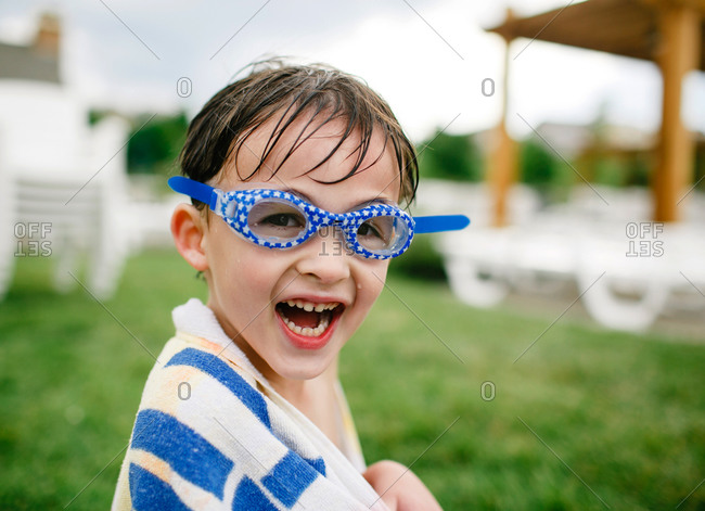 Boy in swim goggles smiling
