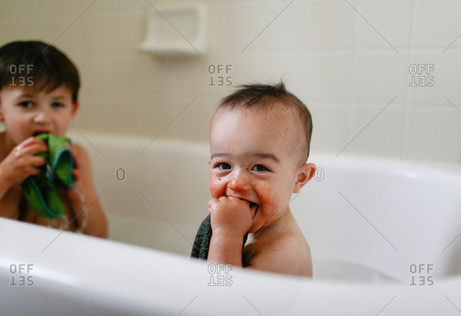 Two boys in a tub