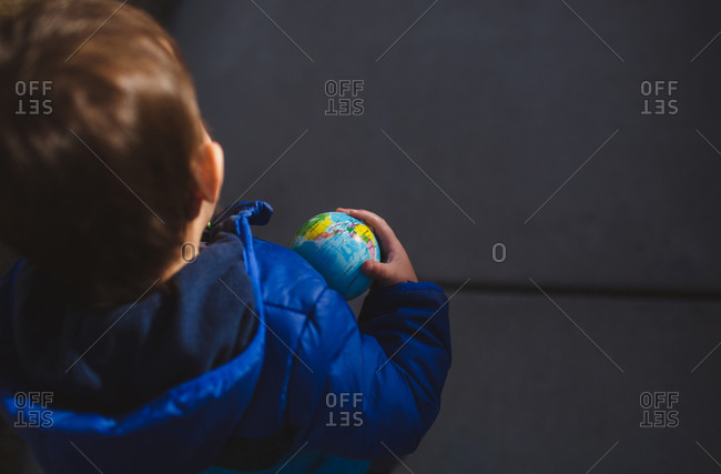 Boy with globe toy