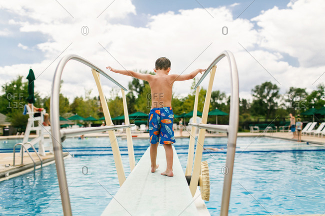 Boy standing on a diving board