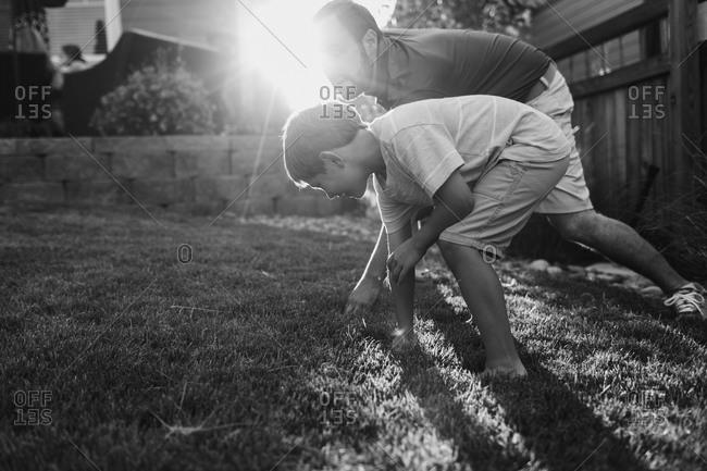 Boy and man racing in yard