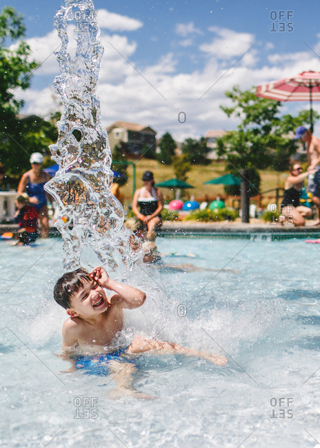 Boy making big splash in pool