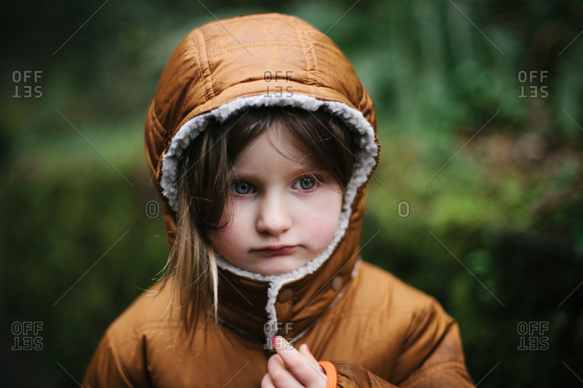 Portrait of a girl with hood on