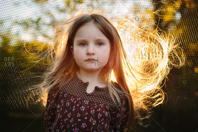 Portrait of a young girl with the sun shining through her hair
