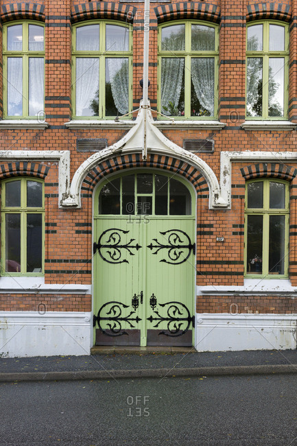 Door with ornate ironwork in the city in Norway