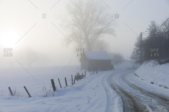 Barn in winter in the countryside in Belgium