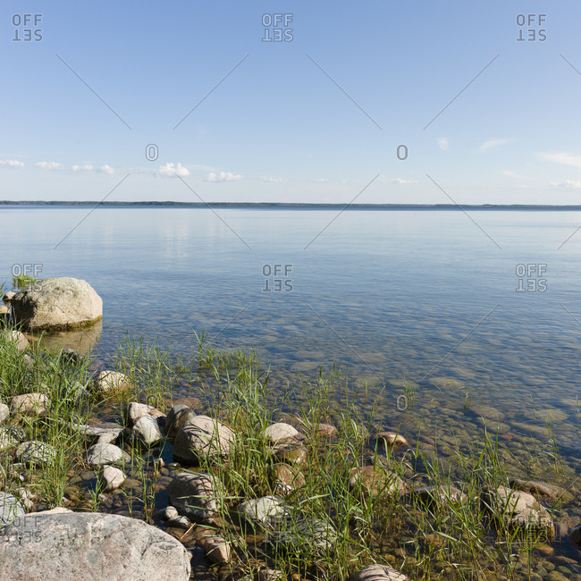 Boulder and stones by lake in Sweden