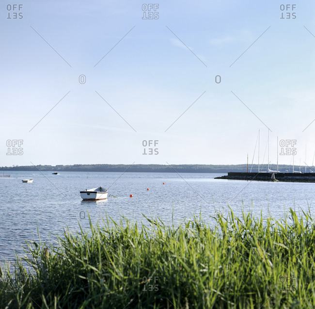 Small fishing boats moored in a calm sea