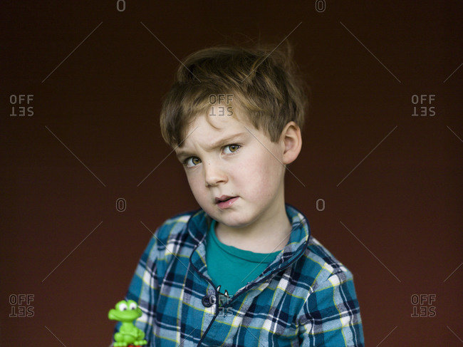 Portrait of a young boy with a puzzled expression