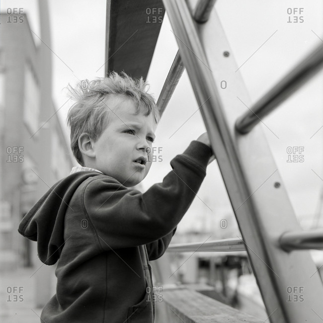 Portrait of a young boy looking at the sea in the harbor