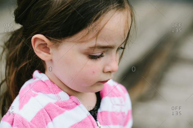 Close up of a Caucasian girl looking down