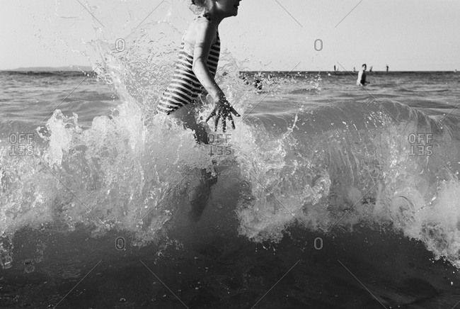 Girl getting splashed by waves