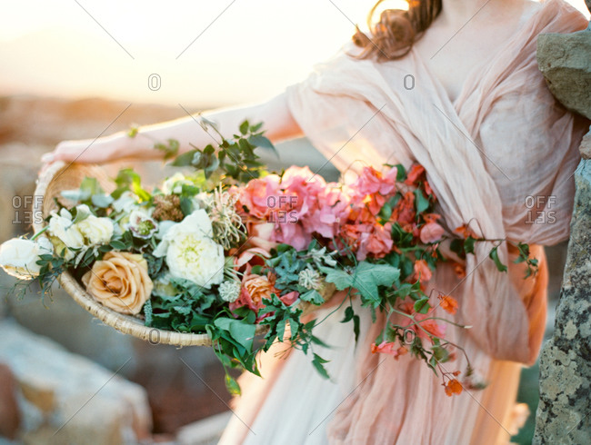 Woman holding basket of flowers