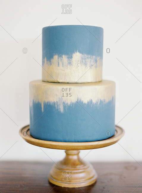 Blue and white two-tiered wedding cake