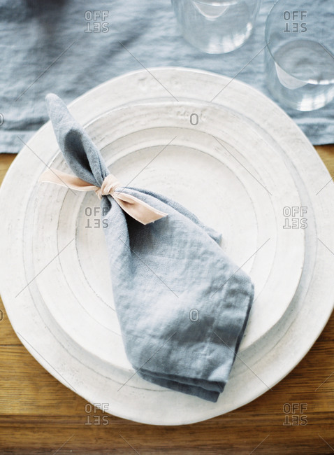Place setting with blue napkin at a wedding reception