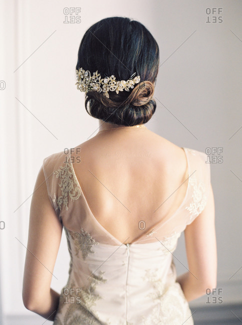 Rear view of a bride in her gown and crystal barrette in her hair