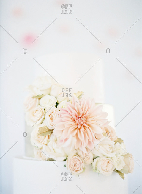 Pink flowers on a three-tiered wedding cake