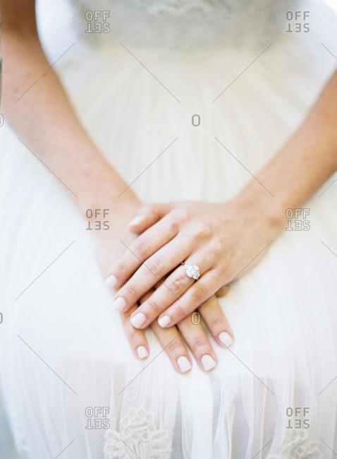 Bride's hands together in her lap