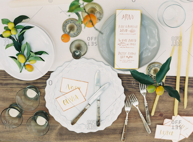 Place setting at a wedding with citrus fruit decorations