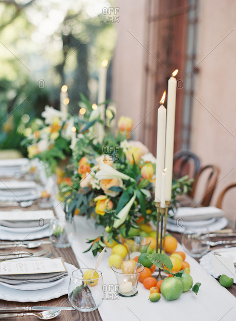 Close up of a wedding table with flower and fruit decorations