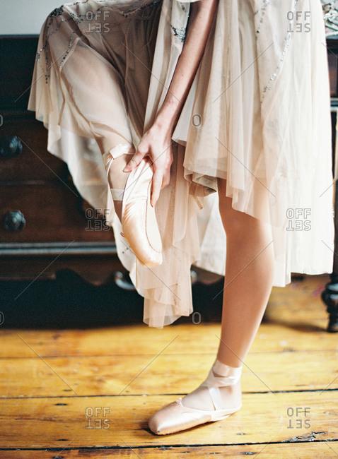 Ballerina rubbing her foot