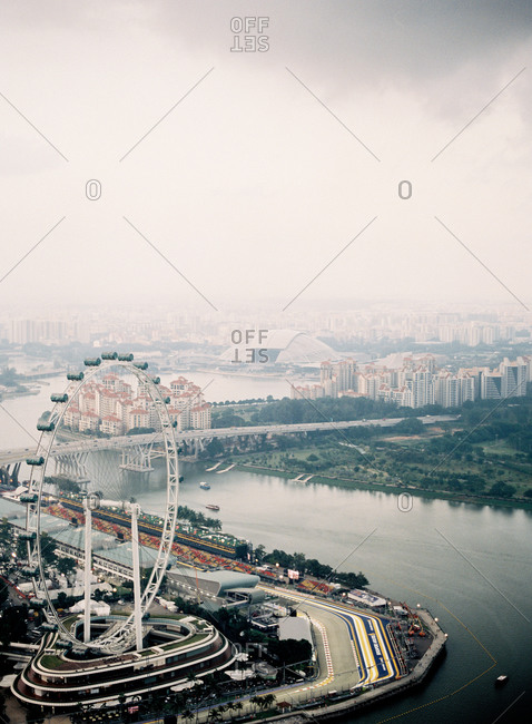 Aerial view of Ferris wheel and river in Singapore