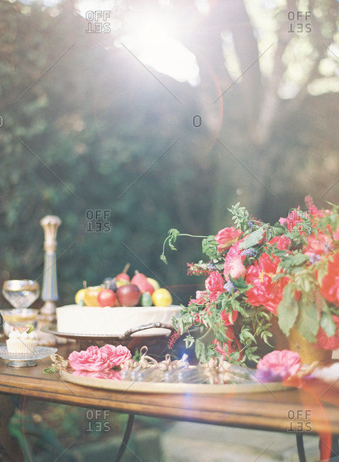 Table at a wedding reception with flowers fruit and bubbles