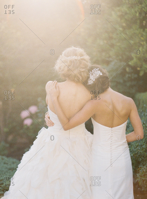 Rear view of bride with arm around her new wife