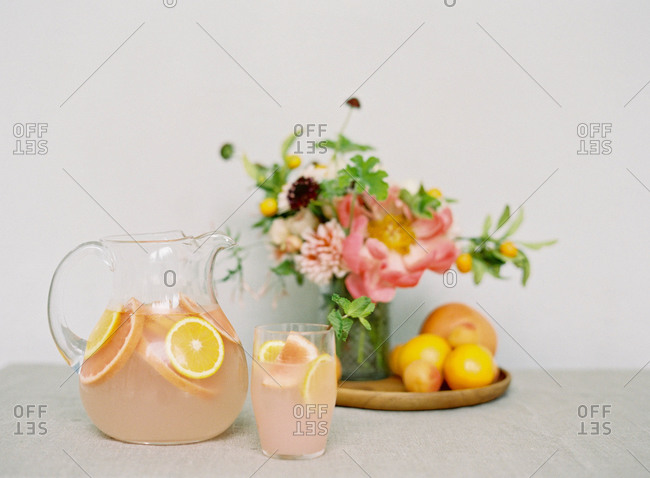 Glass pitcher and glass with citrus fruit juice