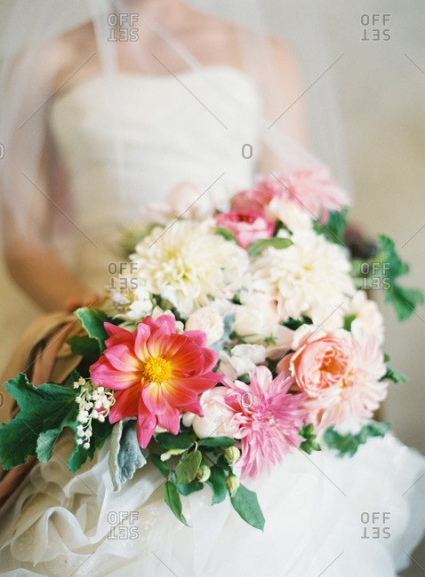 Bride holding bouquet with white and pink flowers