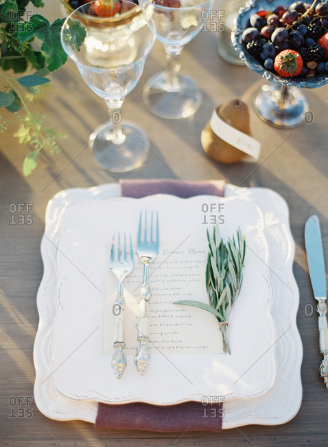 Place setting at a wedding with menu and berries