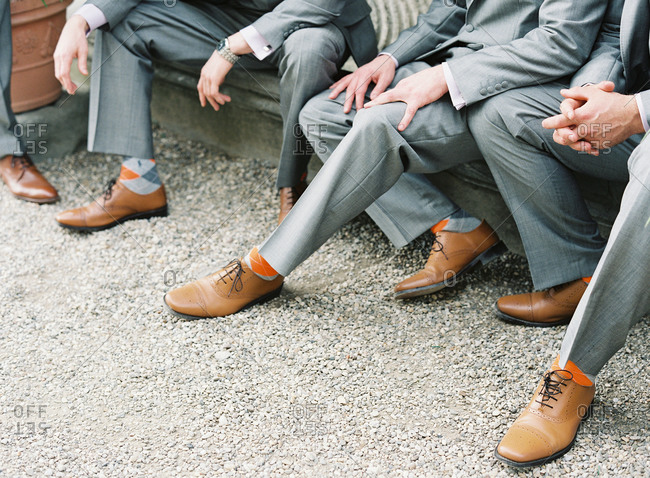 Groomsmen with orange socks and brown shoes
