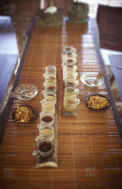 High angle view of coffee and tea sample cups