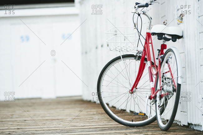 Close up of bicycle leaning on white wall