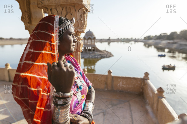 Indian woman admiring view from monument, Jaisalmer, Rajasthan, India
