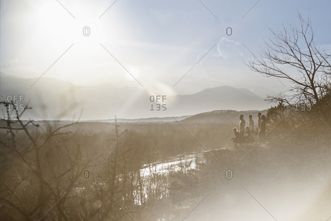 Mountains over river in rural landscape