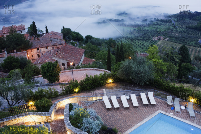 Aerial view of pool terrace on rural hillside, Rocca d'Orcia, Tuscany, Italy