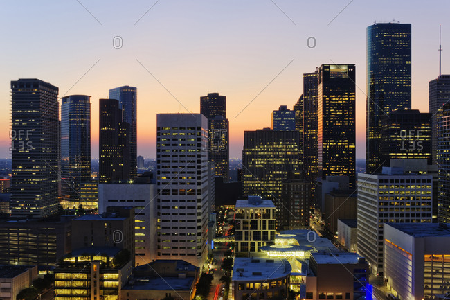 High rise buildings in Houston cityscape illuminated at sunset, Texas, United States