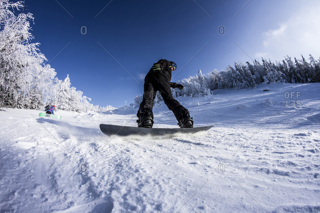 Caucasian snowboarder on snowy slope