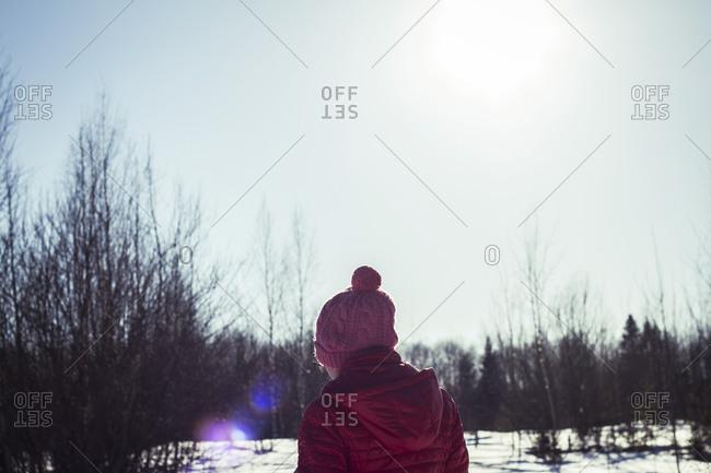 Caucasian girl in snowy field