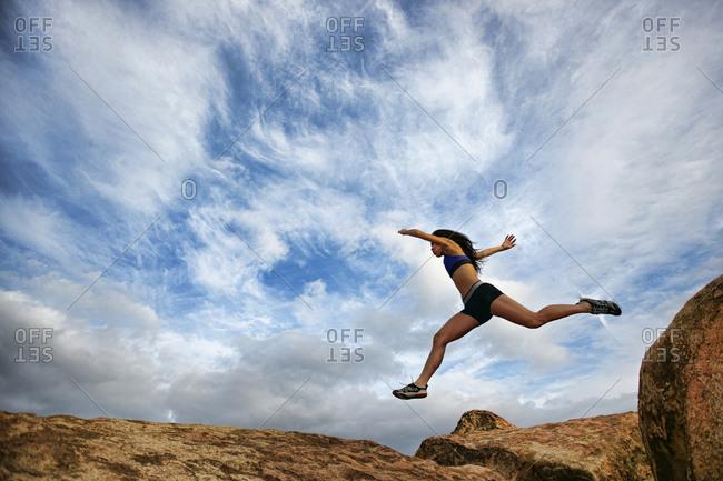 Vietnamese woman running in rocky field