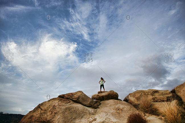 Vietnamese woman standing on rocky hilltop