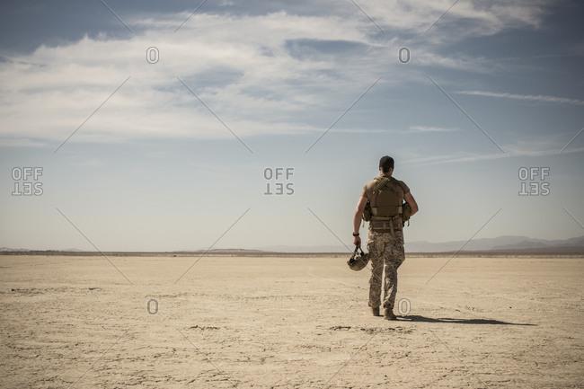 Soldier walking in remote desert