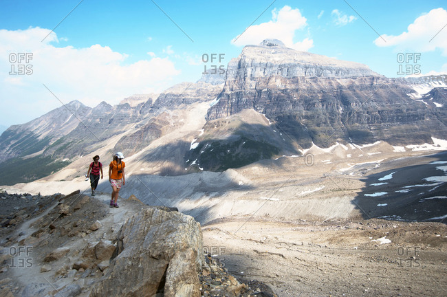 Caucasian mother and daughter hiking on Six Glaciers Trail, Banff, Alberta, Canada