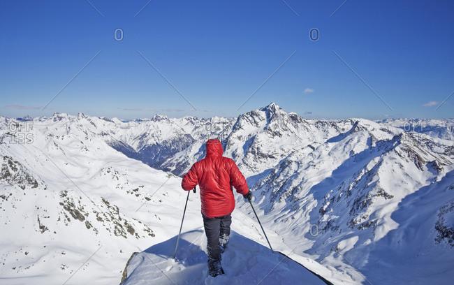 Caucasian man skiing on snowy mountaintop