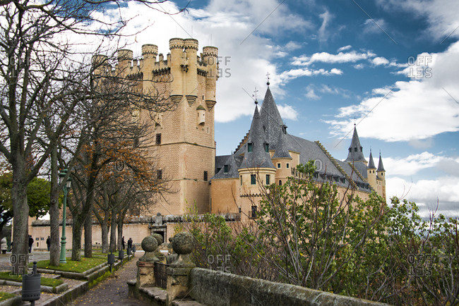 Ornate castle tower and spires with courtyard, Segovia, Spain