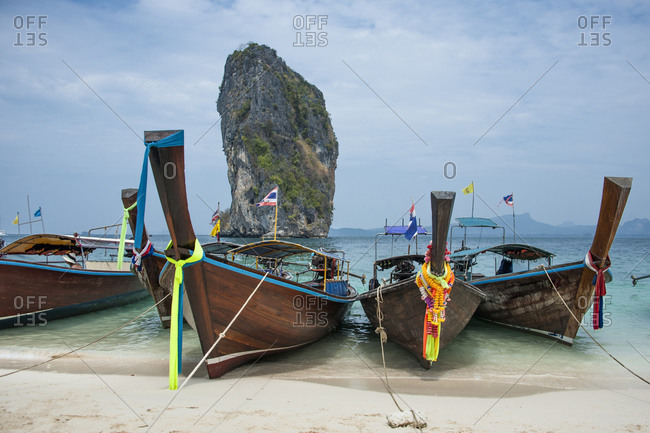Canoes docked on beach - Offset